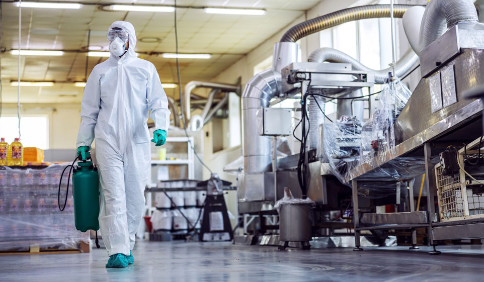 disinfection worker in industrial setting